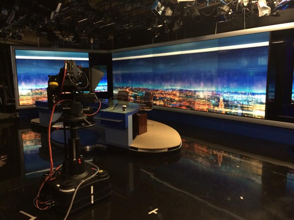 RTE film setup with desk and new Nine O'Clock backdrop of the skyline